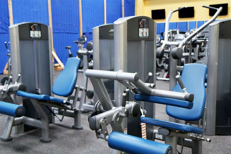Use machines to train your biceps muscle